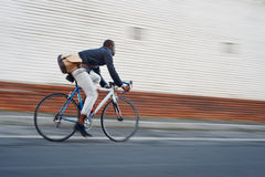 Riding bike black man Stock Image