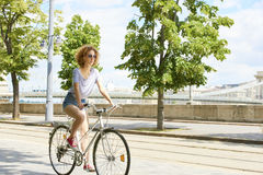 Riding on bike in the city Stock Image