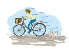 Riding bike with dog Royalty Free Stock Photography