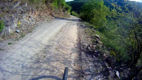 Riding bike on extreme terrain stock video