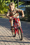 Riding a bike is fun. A young boy having fun riding his bicycle outdoor Stock Photography