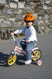Riding bike in a helmet royalty free stock photography