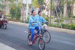 Riding a bike home from work, female workers Royalty Free Stock Photo