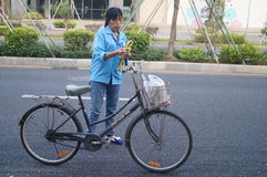 Riding a bike home from work, female workers Royalty Free Stock Images