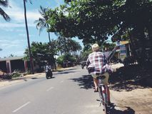 Riding a bike in Muine in South Vietnam Royalty Free Stock Photo