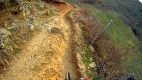 Riding a bike over extreme terrain stock video footage