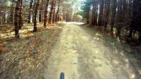 Riding a bike over terrain stock video footage
