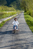 Riding bike in a park Royalty Free Stock Images