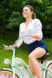 Riding bike in park. Stock Photography