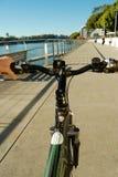 Riding on the bike path Stock Photos