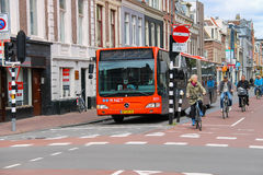 Riding a bike people and big bus in Haarlem Royalty Free Stock Photography