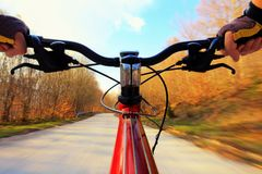 Riding a bike on a road. Riding mountainbike on a asphalt road in nature stock photo