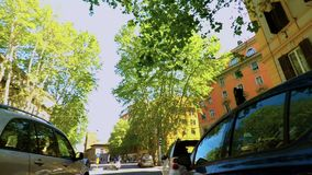 Riding a bike in Rome stopping at a traffic light pov FDV stock footage