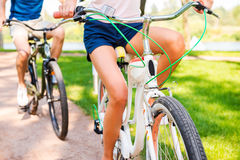 Riding bikes in park. Royalty Free Stock Images