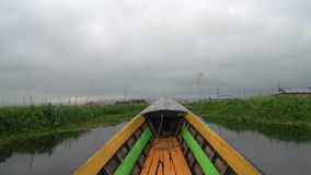 Riding Boat among Floating Village at Inle Lake in Cloudy Weather POV. Shot with a Sony a6300 fps29,97 4k stock video