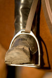 Riding boot. A close up of a horse rider's boot in the stirrup Royalty Free Stock Image