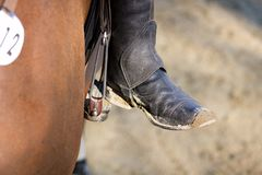 Riding boot. Detail of dirty riding boot standing on the yoke royalty free stock photos