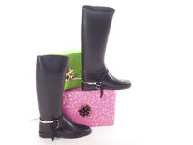 Riding boots and gifts Royalty Free Stock Image