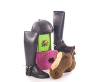 Riding boots and gifts Stock Images