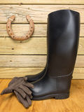 Riding boots and gloves in a stable Stock Image