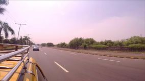 Riding with a Cab on the outer land of Mumbai [Stabilisation; Warm Profile] stock video