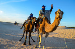 Riding a camel Royalty Free Stock Image