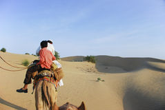 Riding camel in Rajasthan desert. Father and son riding camel in Rajasthan desert Royalty Free Stock Photo