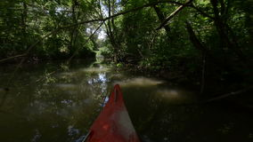 Riding canoe on the river. Angle shot stock footage