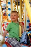 Riding the carousel. Young boy riding the carousel Stock Image