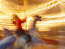 Riding on Carousel Royalty Free Stock Photos
