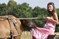 Riding carriage. Beautiful young woman riding an old carriage stock images