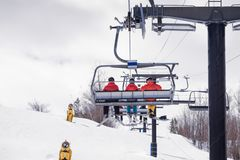 Riding the chairlift at a ski hill royalty free stock images