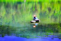 Riding from Cisanti Lake stock image