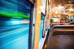 Riding a city bus at night in Bangkok, Thailand. Bangkok, Thailand. Riding a city bus at night in Bangkok, Thailand. Motion blurred street at night Stock Images