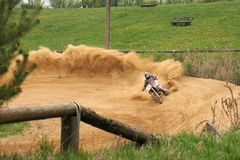Riding a curve with a Motocrossbike stock images
