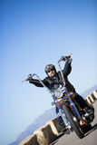 Riding a customized motorcycle Stock Photography