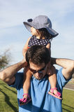 Riding on daddy Royalty Free Stock Photo