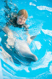 Riding on a dolphin Royalty Free Stock Images