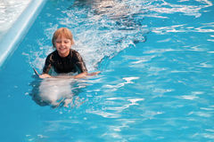Riding on a dolphin 3 Royalty Free Stock Images