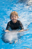 Riding on a dolphin 2 Stock Photos