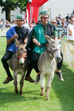 Riding a donkey contest Stock Photos