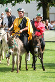 Riding a donkey contest Stock Photography