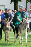 Riding a donkey contest Stock Image