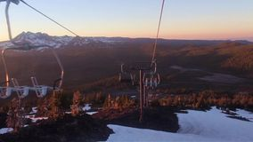 Riding down ski lift at sunset in summer Royalty Free Stock Photos