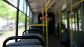 Riding in the almost empty city tramway on summer day stock video footage