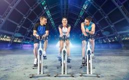 Riding exercise bikes Stock Photo