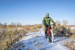 Riding fat bike in winter Royalty Free Stock Image