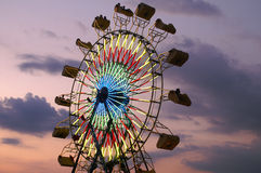 Riding on Ferriswheel Late Evening Royalty Free Stock Photo