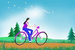 Riding with a flock of birds in the field. Riding woman on a bike with a flock of birds in the afternoon field Stock Images