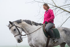 Riding in the fog. Young woman riding in the fog Royalty Free Stock Photography